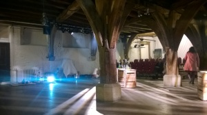 Audience members take their seats in the Merchant Adventurers' Hall.