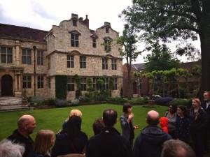 Lara Stafford delivers Photons & Phantoms outside Treasurer's House